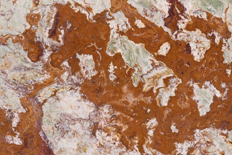 Roestige kleuren marmeren achtergrond stock fotografie