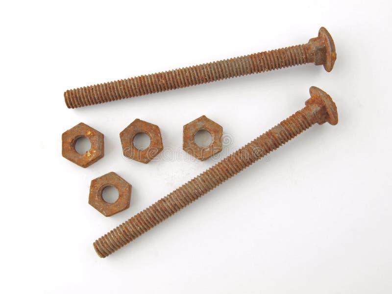 Roestige noten - en - bouten stock afbeelding