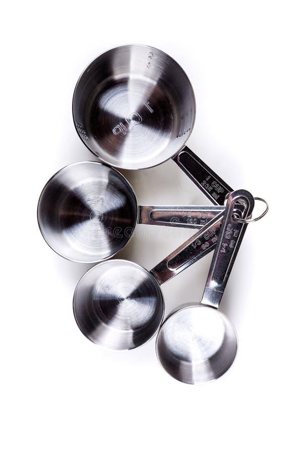 Roestvrij staal vier die samen geknipte koppen meten royalty-vrije stock afbeelding
