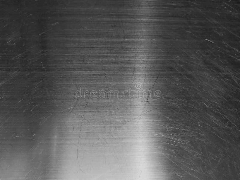 Roestvrij staalblad met een onbegrijpelijk abstract patroon als originele achtergrond stock afbeelding