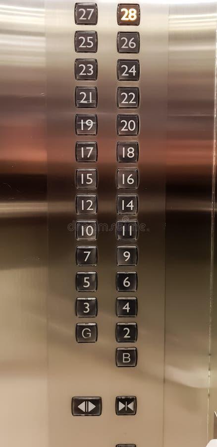 Roestvrij staaldrukknoppen met aantallen in een lift stock foto's