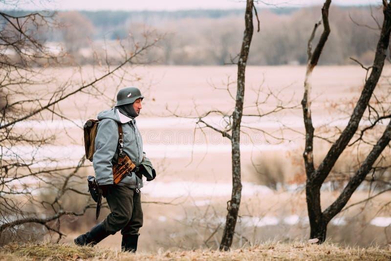Rogachev, Belarus - February 25, 2017: Re-enactor Dressed As Ger. Man Wehrmacht Infantry Soldier In WW II Walking In Autumn Forest stock image