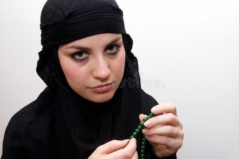 Rogación de la mujer del Islam fotografía de archivo libre de regalías