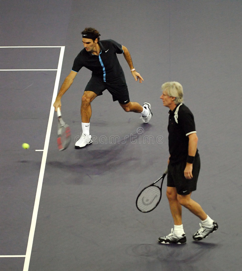 Roger Federer and Bjorn Borg in actions stock image