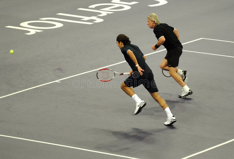 Roger Federer and Bjorn Borg in actions royalty free stock image