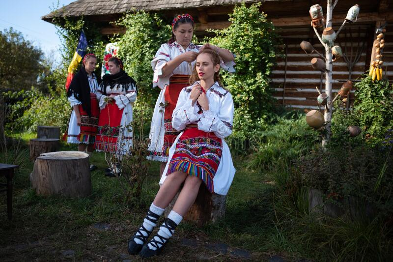 Rogoz, Romania, October 12th, 2019, Portraiture of children wearing traditional in Maramures making up hair stock photo