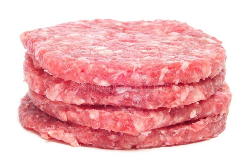 Rohe Burger lizenzfreies stockbild