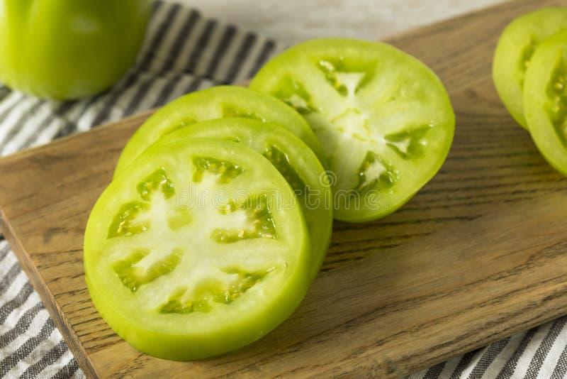 Rohe grüne organische Tomaten lizenzfreie stockbilder