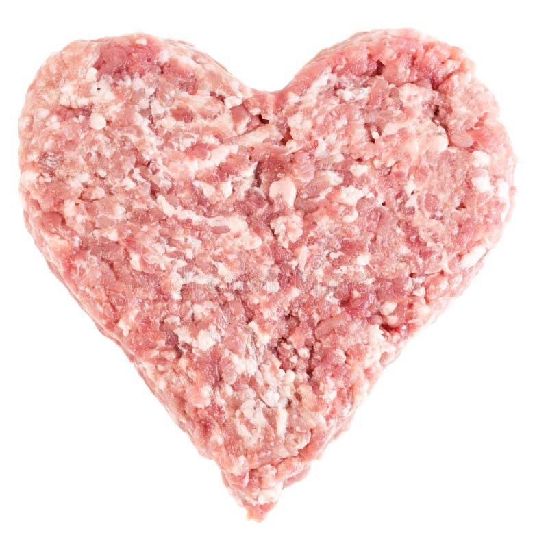 Roher Burger des roten Fleisches für Hamburger in Form des Herzens stockbilder
