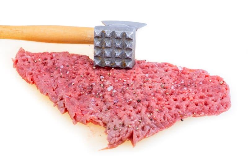 Rohes Fleisch und Hammer stockfoto