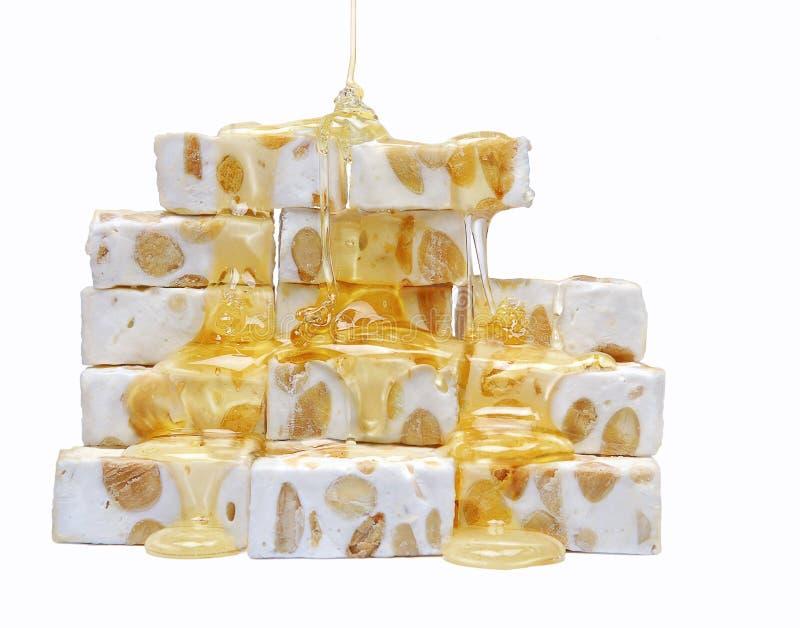 Rohes französisches Nugat mit Honig lizenzfreie stockbilder