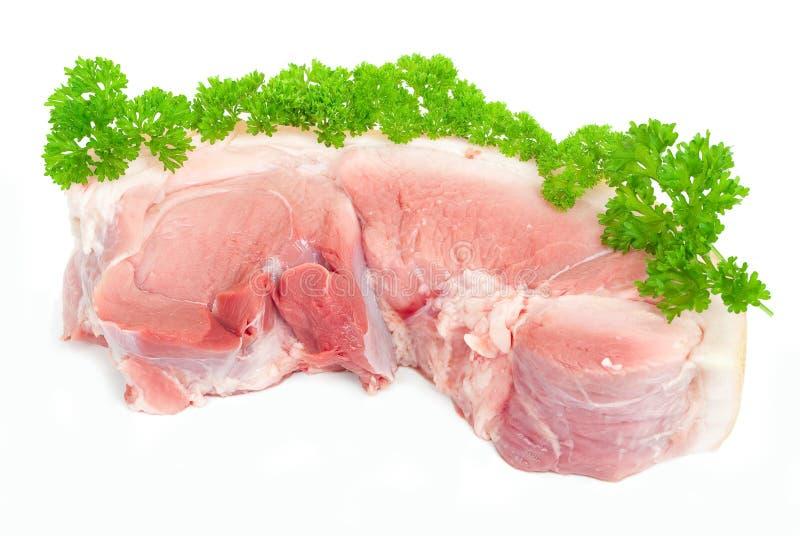Rohes Schweinefleisch mit Petersilie lizenzfreies stockbild