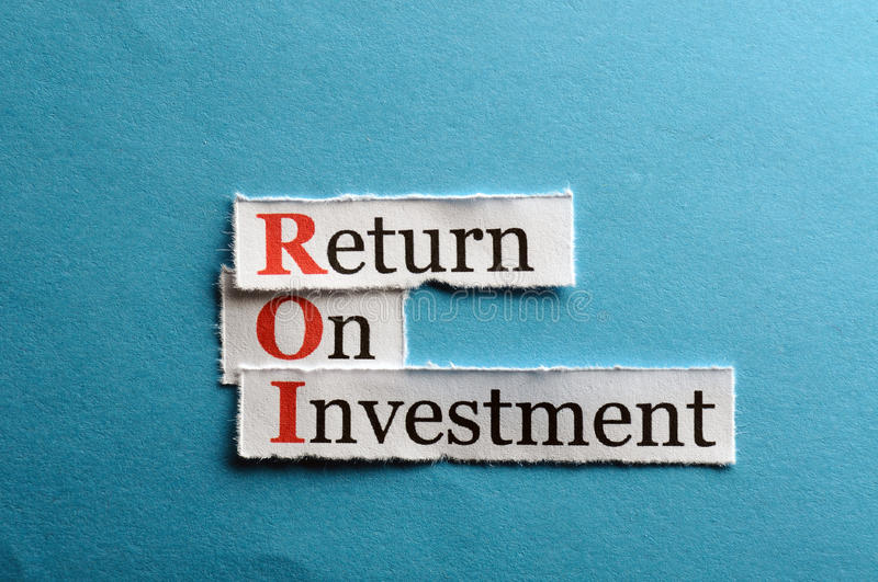 Roi abbreviation. ROI acronym on blue paper , Return On Investment royalty free stock images