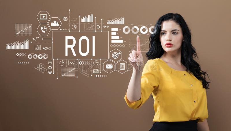 ROI with business woman. On a brown background royalty free stock photo