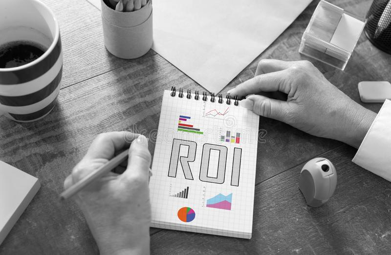 Roi concept on a notepad. Roi concept drawn on a notepad royalty free stock photos