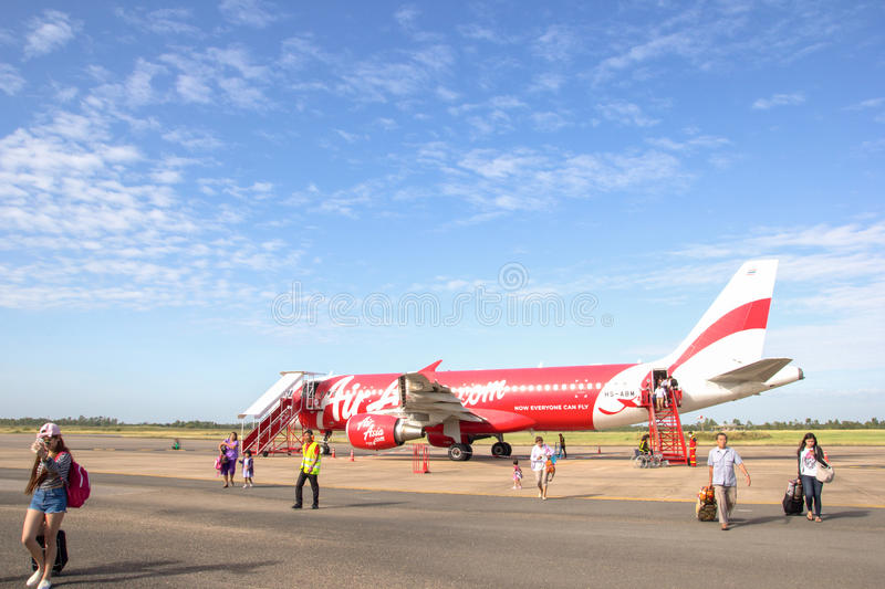 ROI ET, THAILAND - NOV01, 2015: Thai Air Asia Plane landed at Roi et airport on June 18, 2015 in Roi et, Thailand. Air Asia. Company is the largest low cost stock photography