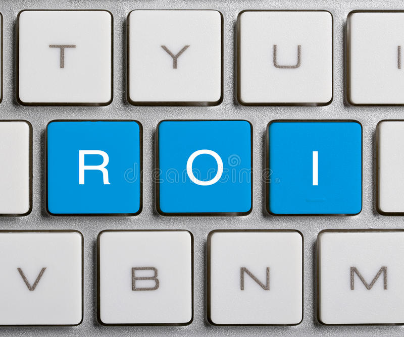 ROI On Keyboard. ROI text on the colorful buttons of the keyboard royalty free stock images