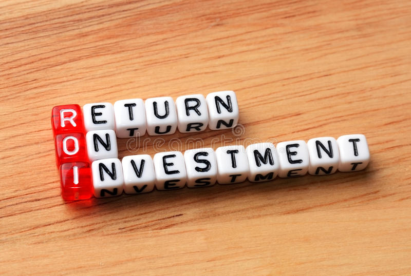 Roi return on investment wood. ROI Return On Investment written on dices on wooden background royalty free stock photos