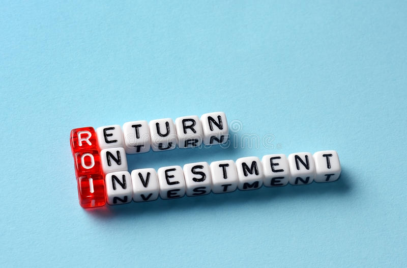 Roi return on investment. Written on dices on blue background stock images