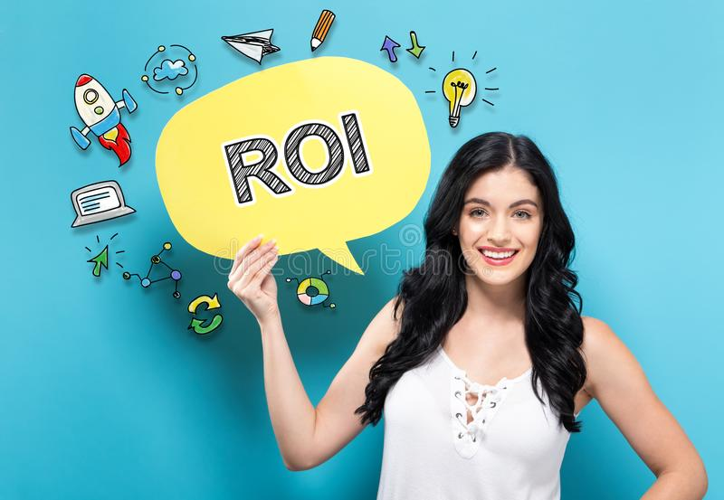 ROI with woman holding a speech bubble. ROI with young woman holding a speech bubble stock image