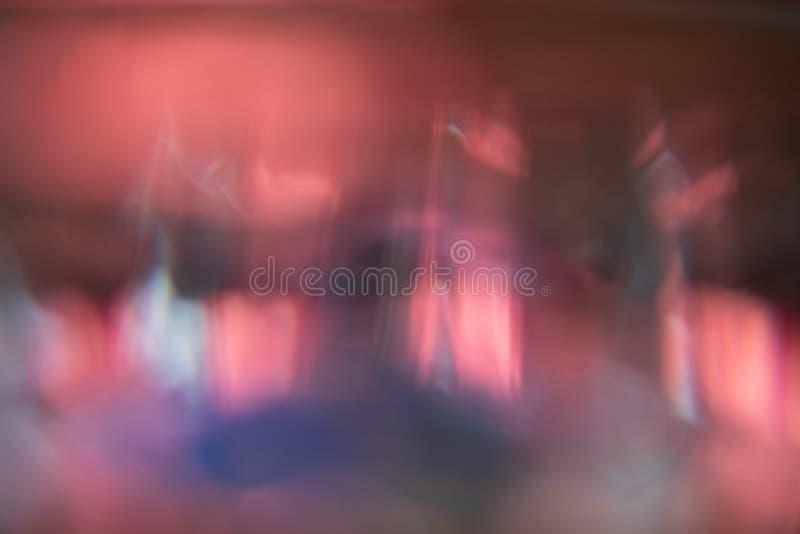 Rojo, azul y rosado fuera de fondo del extracto del foco fotografía de archivo libre de regalías
