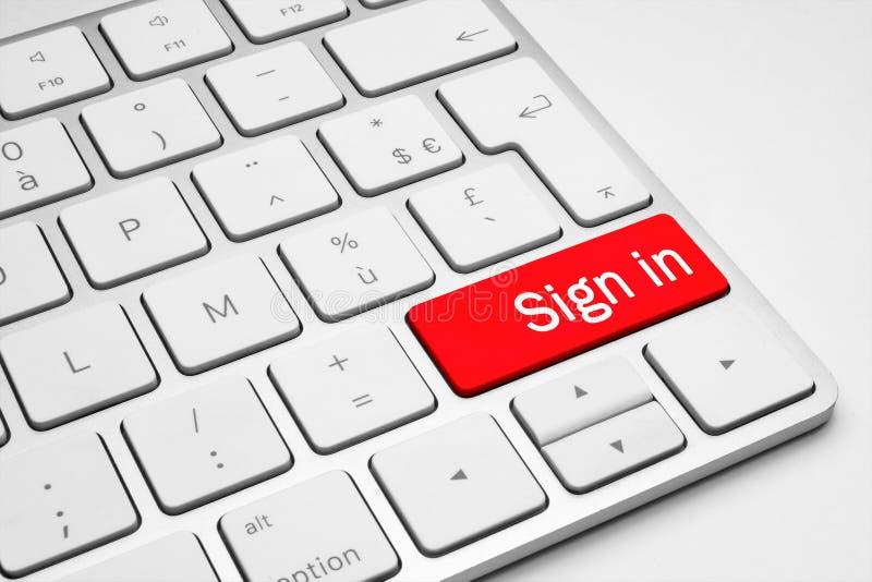 Rojo firme adentro el botón en un teclado blanco fotos de archivo libres de regalías