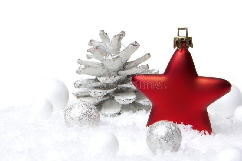 Rojo y plata de la decoración de la Navidad imagen de archivo