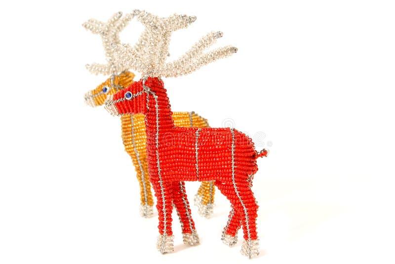Rojo y renos de la Navidad del oro foto de archivo libre de regalías