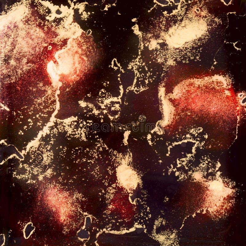 Rojo y tinta del alcohol del oro ilustración del vector