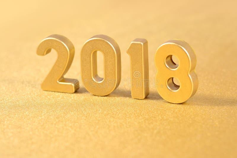 2018 rok złote postacie na złotym obrazy royalty free