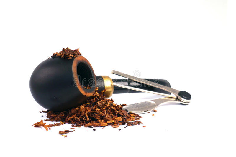 Rokend pijp, tabaks en pijphulpmiddel stock afbeeldingen