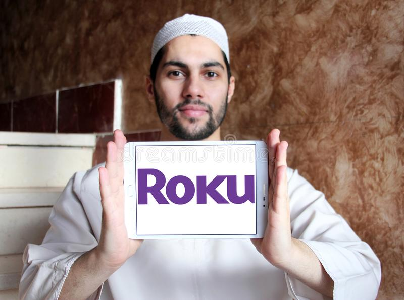 Roku company logo. Logo of Roku company on samsung tablet holded by arab muslim man. Roku is an American publicly traded company that manufactures home digital royalty free stock images