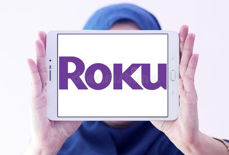 Roku company logo. Logo of Roku company on samsung tablet holded by arab muslim woman. Roku is an American publicly traded company that manufactures home digital stock image