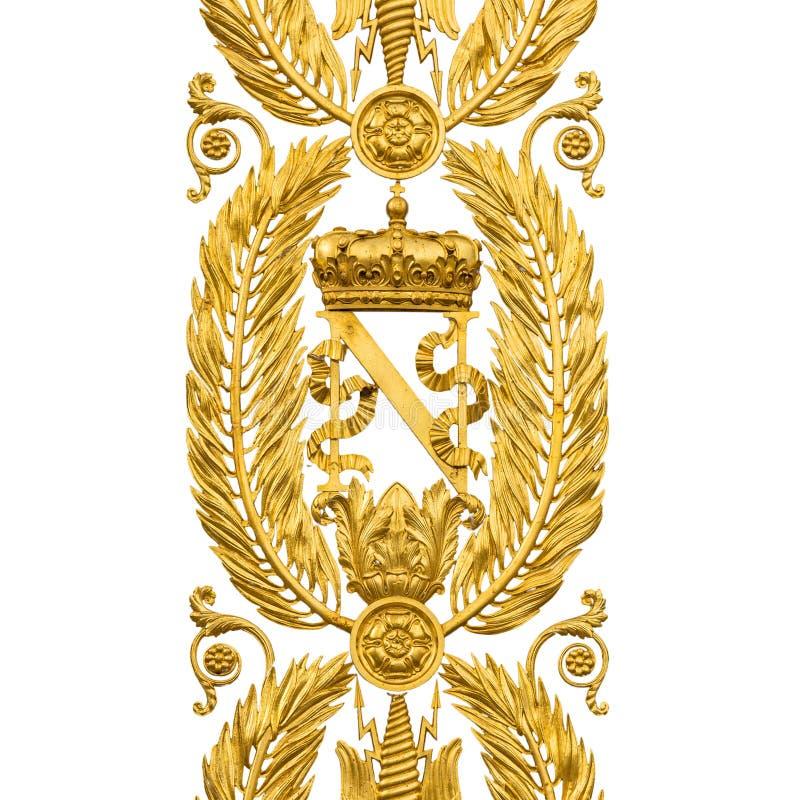 Rolamentos heráldicos dourados de Napoleon Bonaparte, portas no branco fotografia de stock