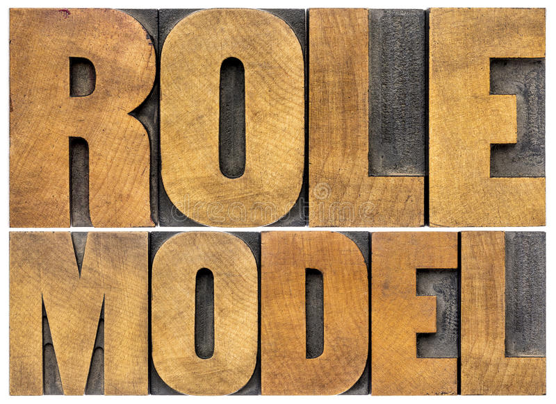 Role model typography. Role model - leadership concept - isolated word abstract in letterpress wood type royalty free stock photos