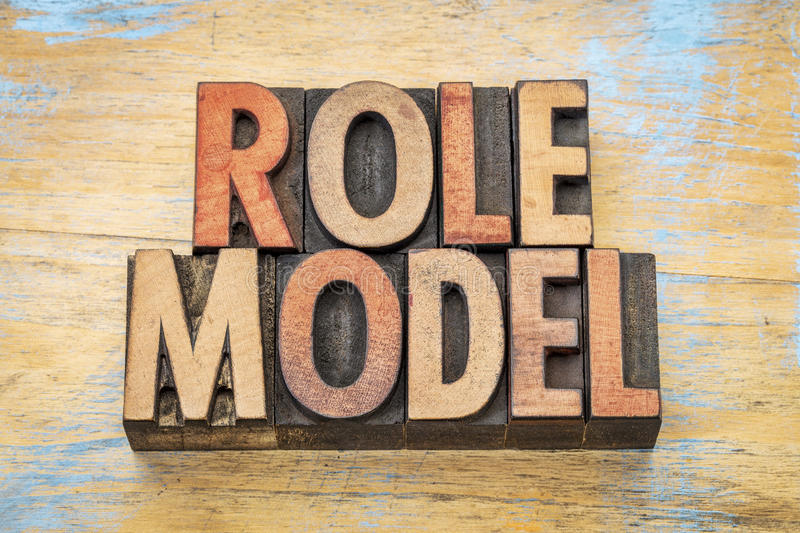 Role model in wood type. Role model - word abstract in vintage letterpress wood type printing blocks stock photography