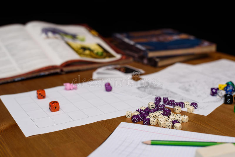 Role playing game set up on table isolated on black background. Stock photo royalty free stock photography