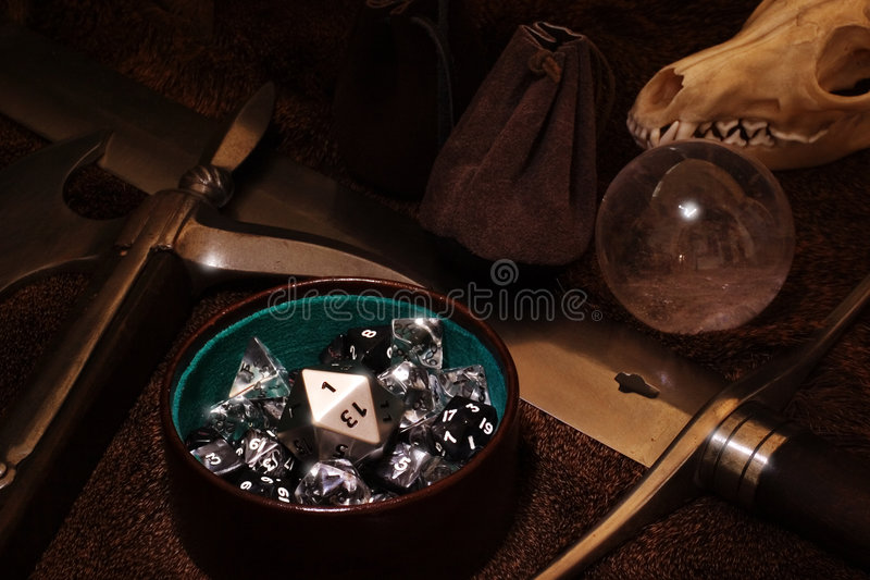 Role playing game still life. With dice and weapons stock photography