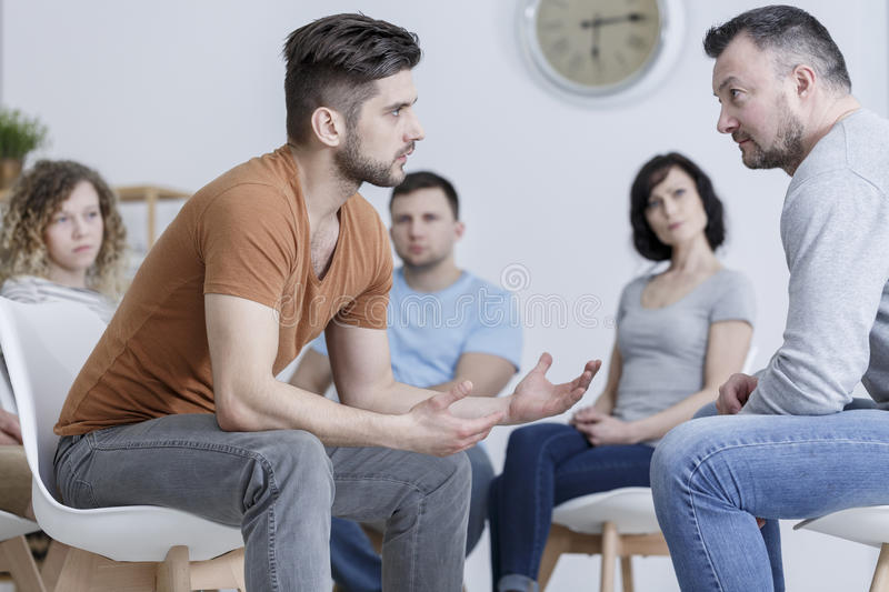Role playing during psychotherapy. Role playing method during group psychotherapy session royalty free stock photo