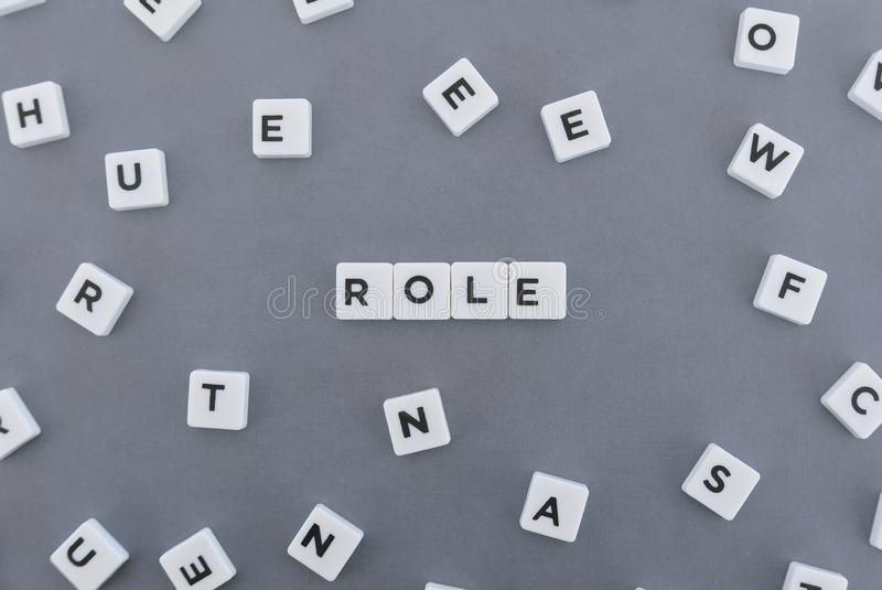 Role word made of square letter word on grey background. Business leadership teamwork text responsibility people job know motivation personality employment royalty free stock photos