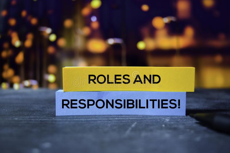 Roles and Responsibilities! on the sticky notes with bokeh background royalty free stock image