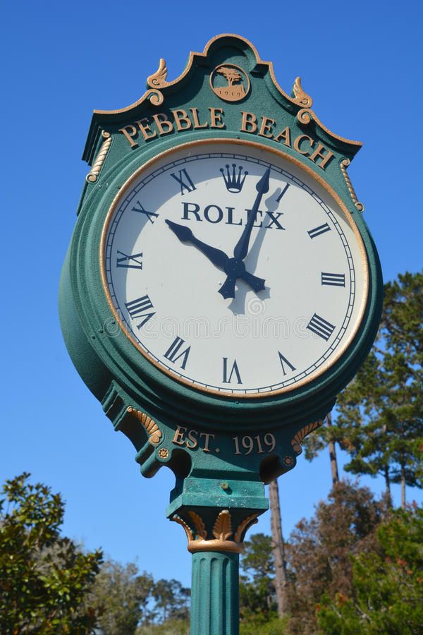 Rolex clock in the public golf course of Pebble Beach royalty free stock photos