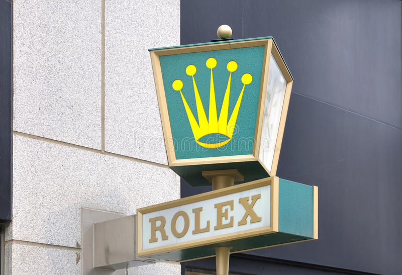 Rolex Logo on the wall royalty free stock images