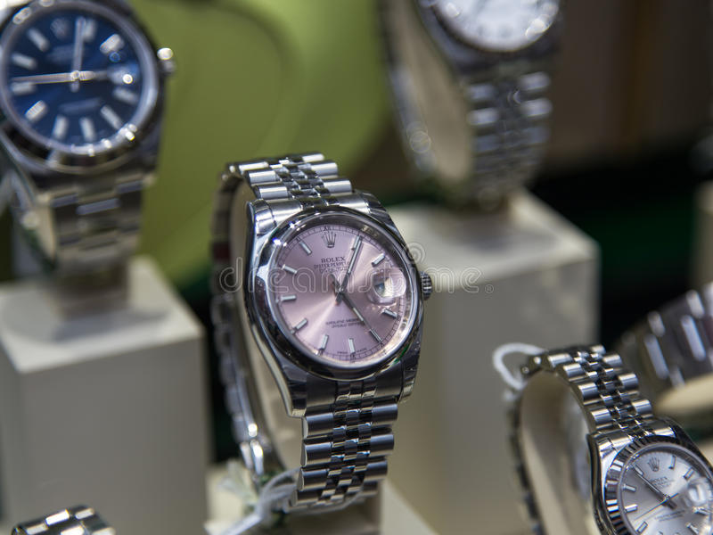 Rolex luxury watch. Swiss made Rolex expensive watch is displayed for sale in luxury watches shop stock photos