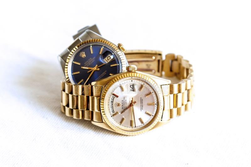 Rolex Oyster Perpetual Day- Date and Oyster Blue  watch on white background stock images