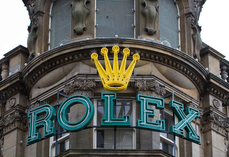 Rolex Store And Sign. NEWCASTLE, UK - OCTOBER 17, 2016. The exterior of the luxury watchmaker Rolex's store and shop with a large Rolex sign on the facade in royalty free stock photos