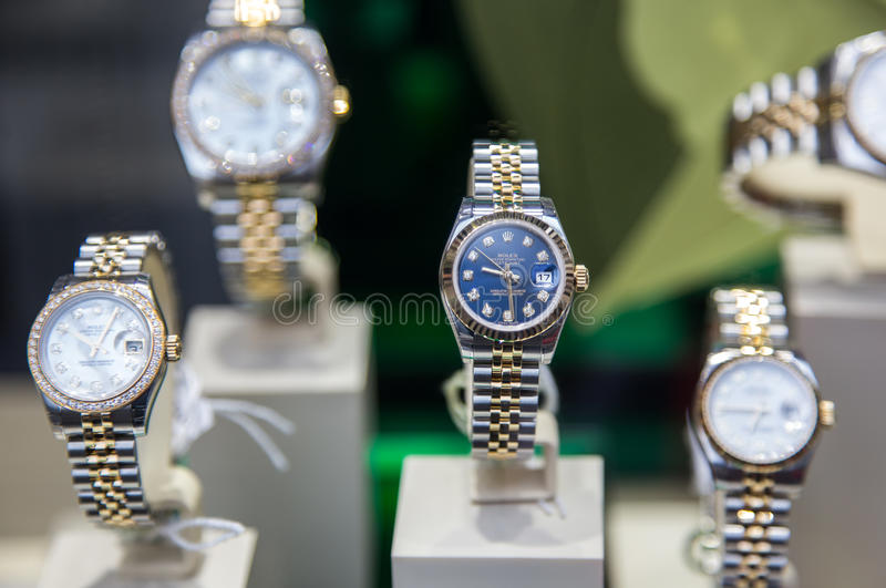 Rolex watches. Swiss made Rolex expensive watch is displayed for sale in luxury watches shop royalty free stock photography
