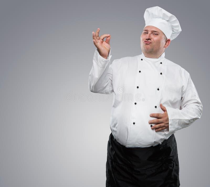 Rolig överviktig kock arkivbild