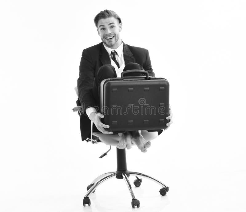 Rolig affärsidé Kontorsarbetare med enfaldig framsidasnurr i stol royaltyfri fotografi