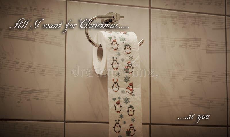 Rolig jultemabedrift festlig toalettrulle arkivfoto
